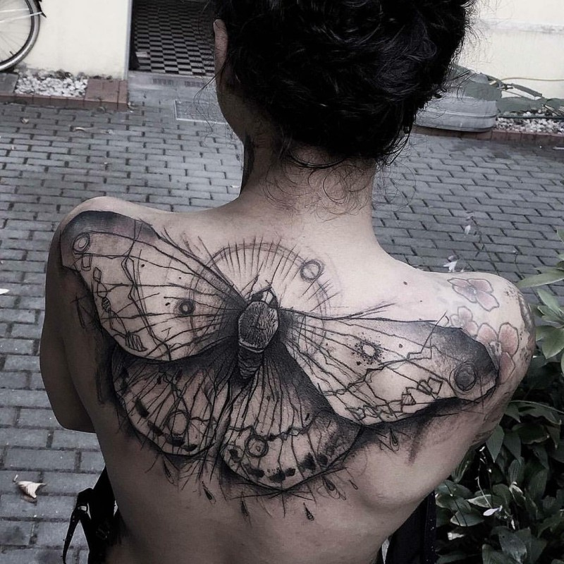 Marvelous black ink upper back tattoo of big butterfly