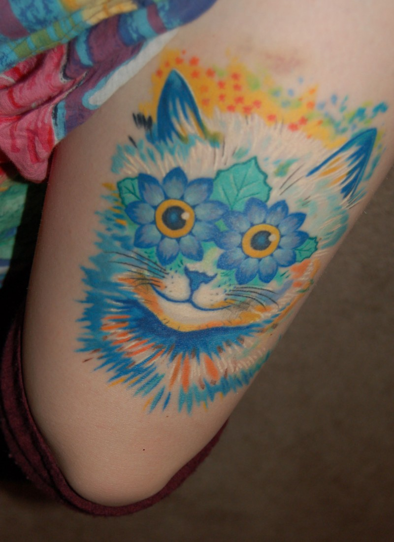 Marvelous bright colored cat with flowers eyes designed thigh tattoo