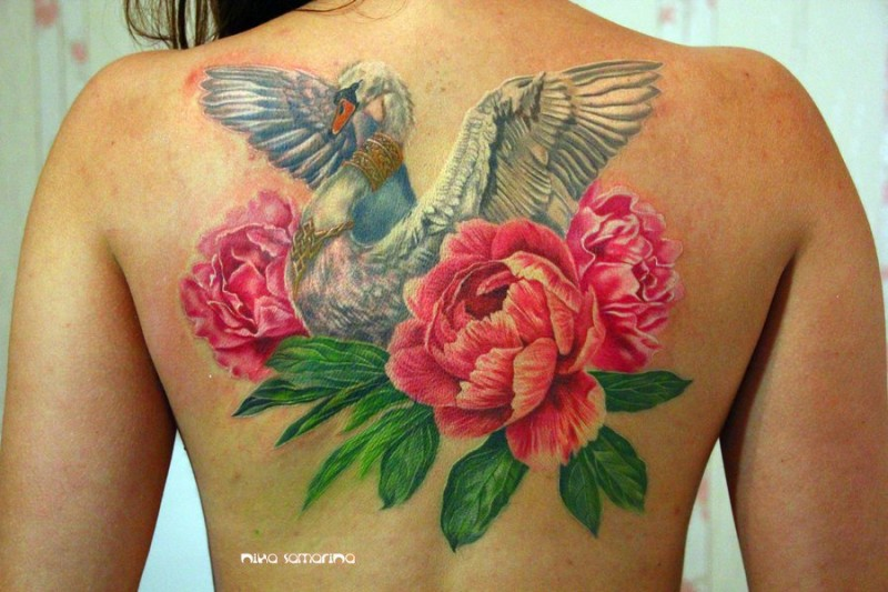 Marvelous colored back tattoo of swan with flowers and jewelry
