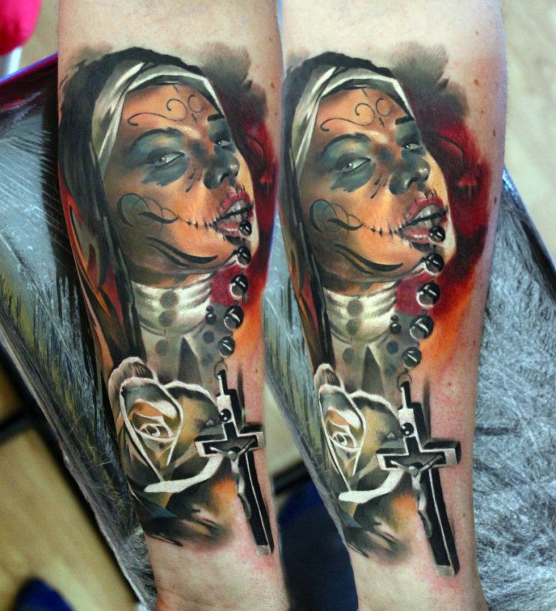 Marvelous colored forearm tattoo of creepy Mexican woman with cross