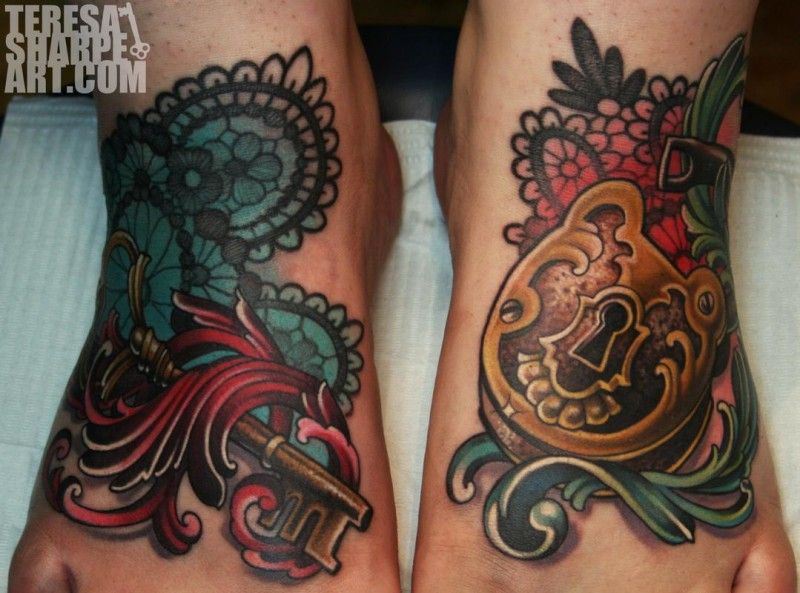 Marvelous colored golden lock with key tattoo on feet stylized with ornamental flowers