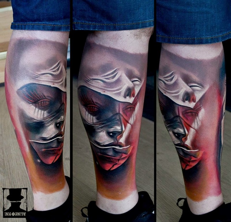 Marvelous colored leg tattoo of mystical human faces