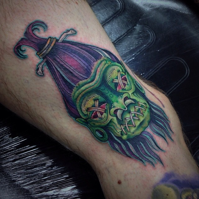 Marvelous colored tribal voodoo doll tattoo on ankle zone