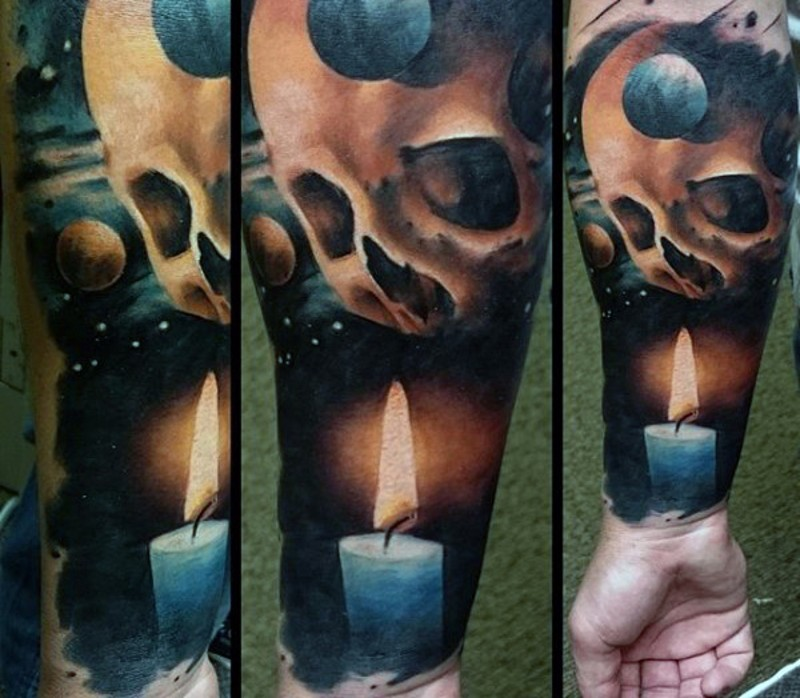 Marvelous colorful mystic skull with candle tattoo on sleeve
