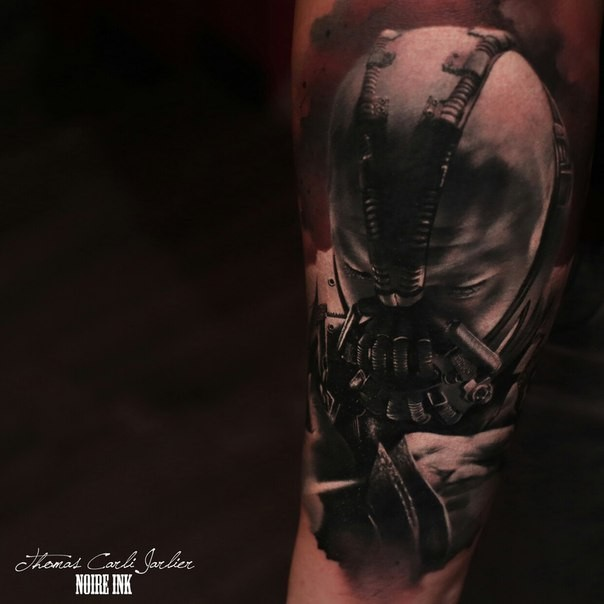 Marvelous looking colored arm tattoo of Bane face