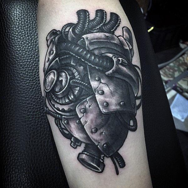 Marvelous looking detailed black ink forearm tattoo of human biomechanical heart