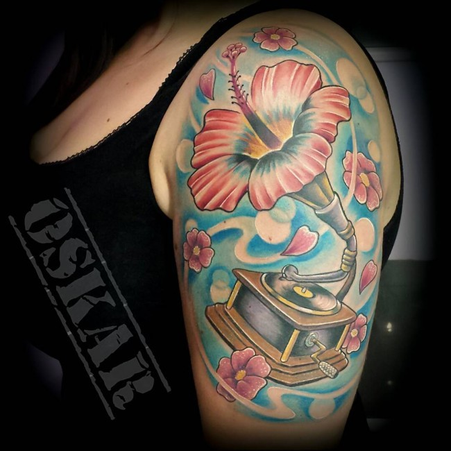 Marvelous looking multicolored flower shaped gramophone tattoo on shoulder