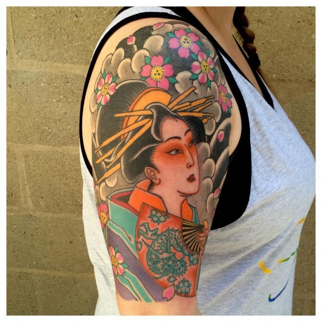 Marvelous multicolored shoulder tattoo of Asian woman with flowers