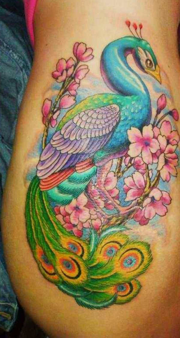 Marvelous very beautiful looking illustrative style colored side tattoo of peacock with blooming tree branch