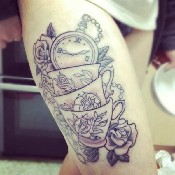 Marvelous very detailed black and white cups with clock tattoo on thigh with flowers