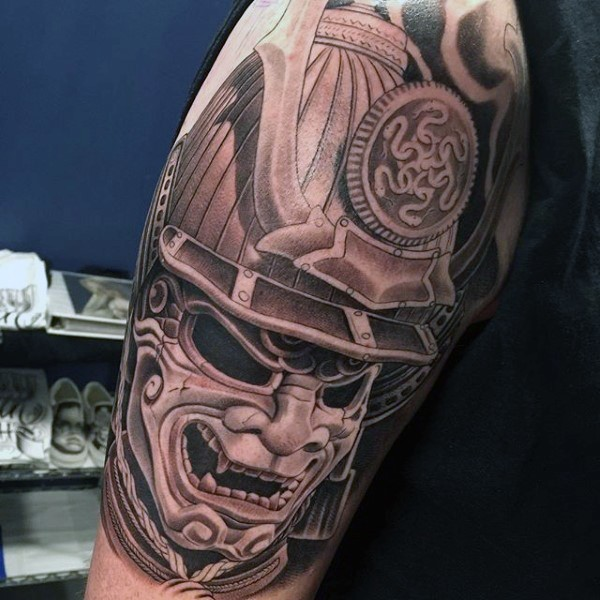 Marvelous very detailed colored antic samurai helmet tattoo on shoulder