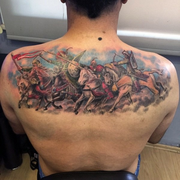 Marvelous very detailed colorful medieval warriors tattoo on upper back