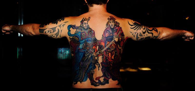 Marvelous whole back tattoo of Asian samurai warriors
