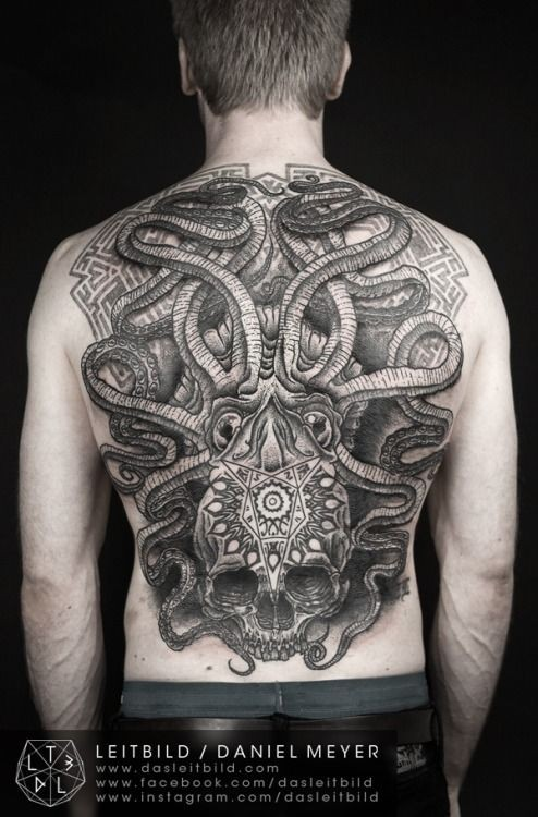 Massive Aztec style black and white mystical octopus tattoo with skull on whole back