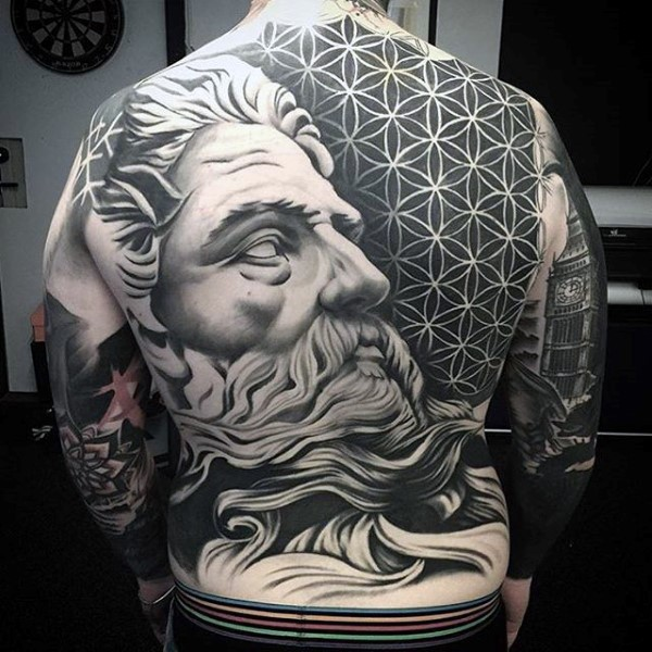 Massive black and white antic statue with tribal ornaments tattoo on whole back