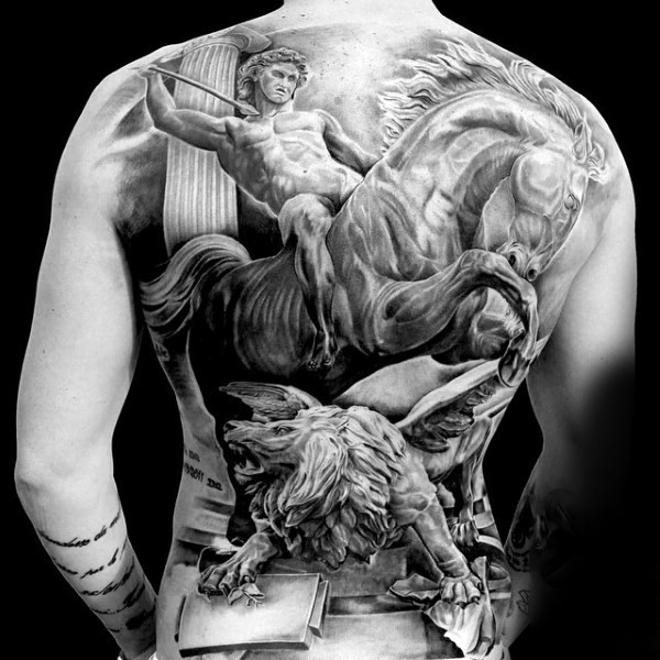 Massive black and white detailed antic warrior with horse and lion tattoo on whole back