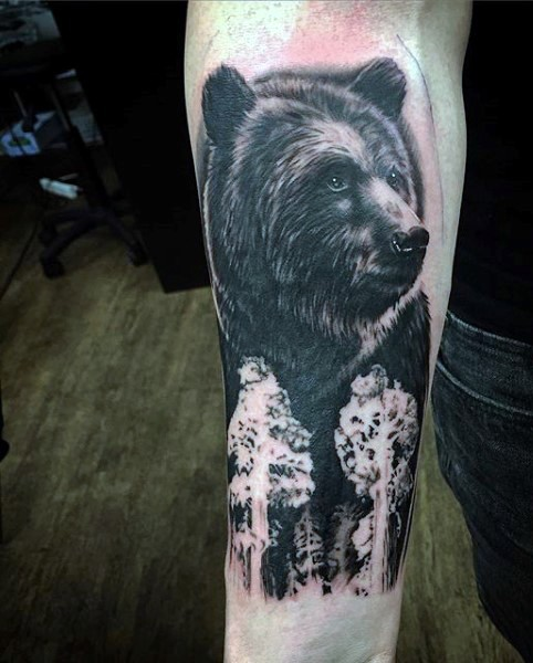Massive black and white detailed bear tattoo on arm