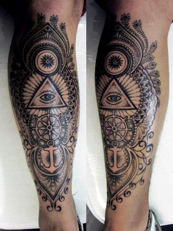 Massive black and white half nautical half masonic style detailed tattoo on leg