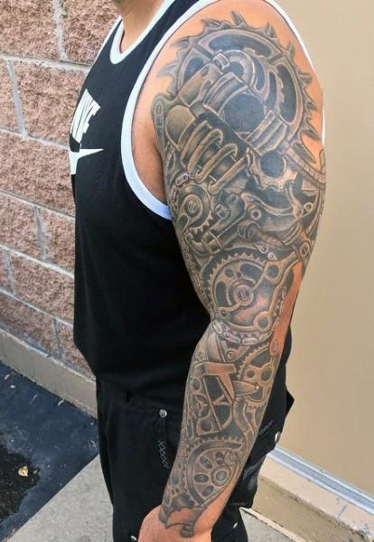 Massive black and white mechanical tattoo on sleeve
