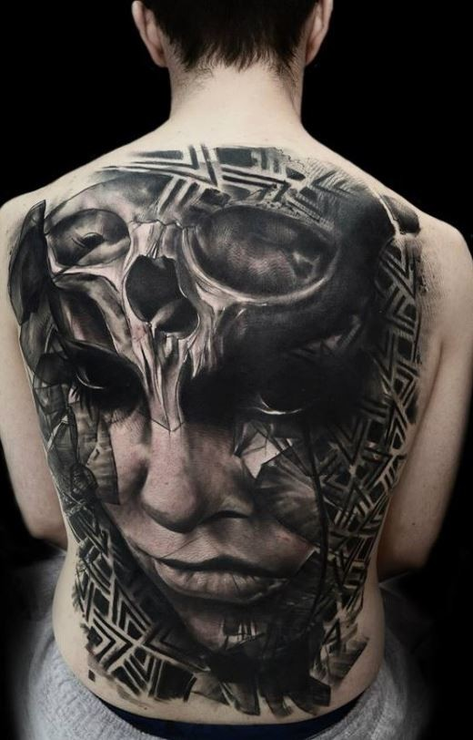 Massive black and white mystical tribal woman portrait tattoo on whole back with human skull