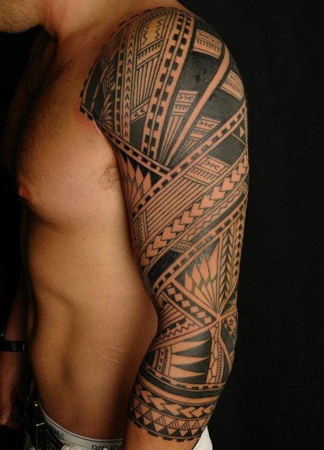 Massive black and white Polynesian ornaments tattoo on sleeve