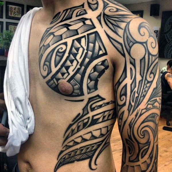 Massive black and white simple Polynesian ornaments tattoo on chest and shoulder