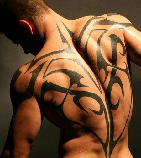 Massive black and white tribal style tattoo on whole back