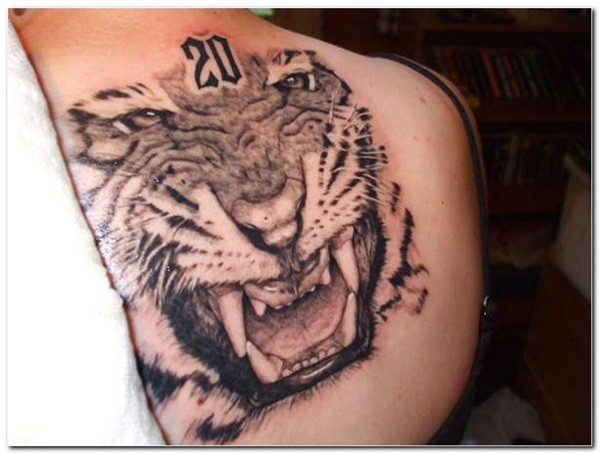 Massive black and white very detailed roaring tiger tattoo on back with little number