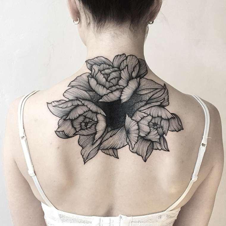 Massive black ink dot style painted upper back tattoo of various flowers