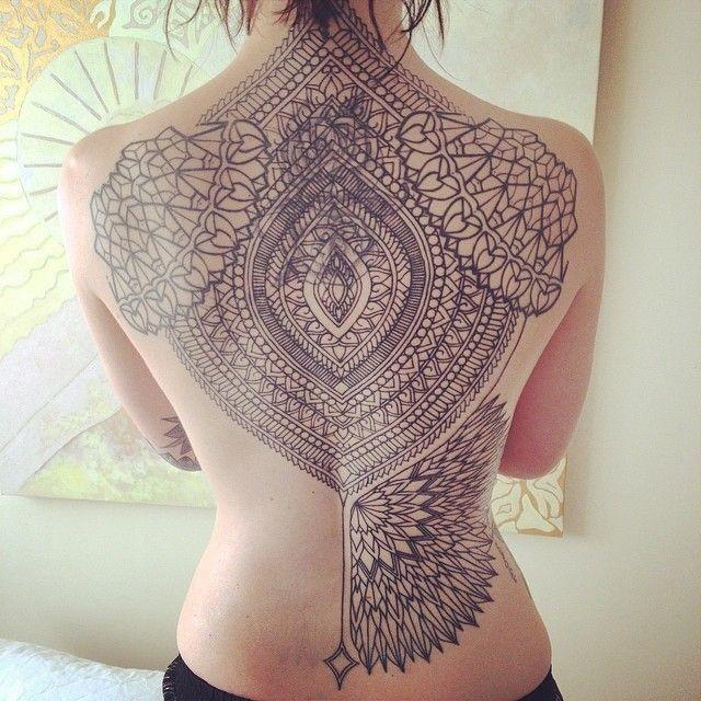Massive black ink Hinduism ornaments tattoo on whole back