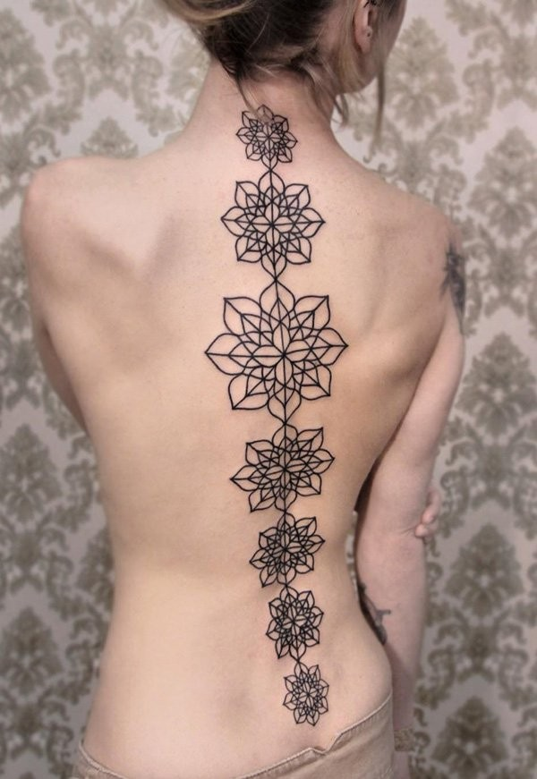 Massive black ink simple designed on whole back tattoo of various flowers