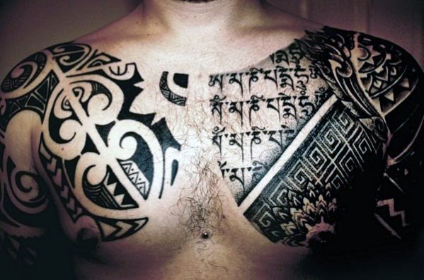 Massive black ink tribal ornaments tattoo on chest and shoulders