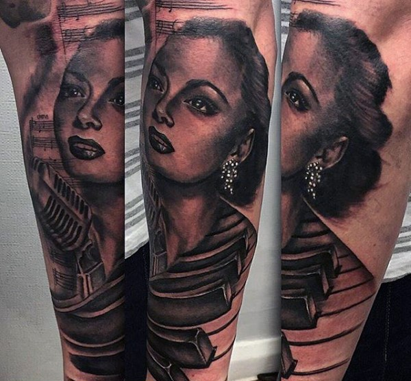 Massive black ink very realistic looking woman singer with piano keys and microphone tattoo on sleeve