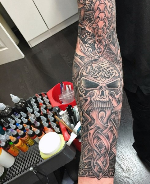 Massive Celtic style designed and detailed tattoo on sleeve