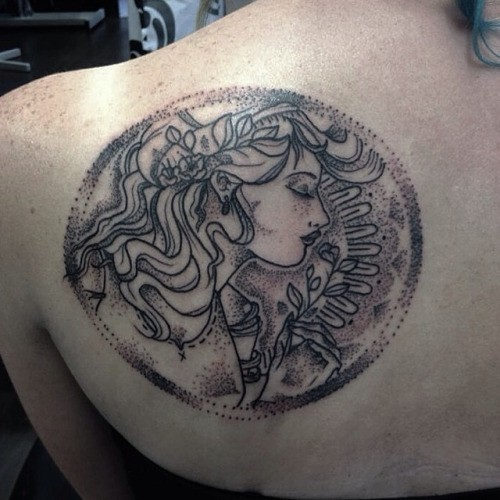 Massive circle shaped upper back tattoo of woman portrait