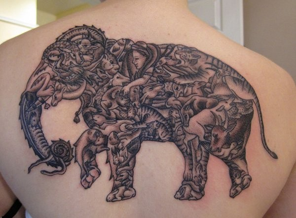 Massive colored elephant tattoo on upper back stylized with various animals