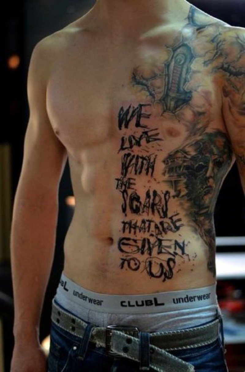 Massive colored half chest tattoo on monster face and lettering