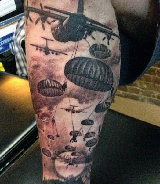 Massive colored military airborne tattoo on thigh
