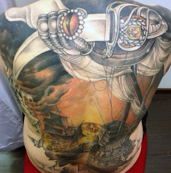 Massive colorful mystical nautical tattoo with antic sword on whole back