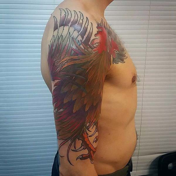 Massive colorful very detailed cock tattoo on arm
