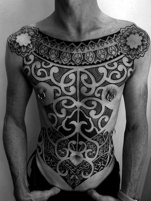 Massive detailed tribal ornaments tattoo on whole chest and belly