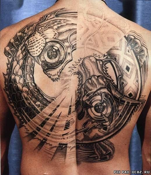 Massive futuristic style colored snake shaped tiger tattoo on back stylized with tribal ornaments