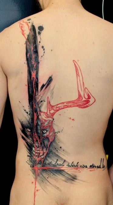 Massive multicolored half back tattoo of mystic deer shaped beast with lettering