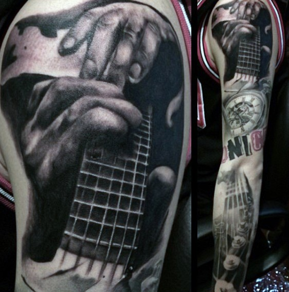 Massive multicolored music themed tattoo on sleeve