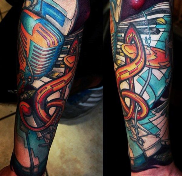 Massive multicolored music themed tattoo with various instruments on sleeve