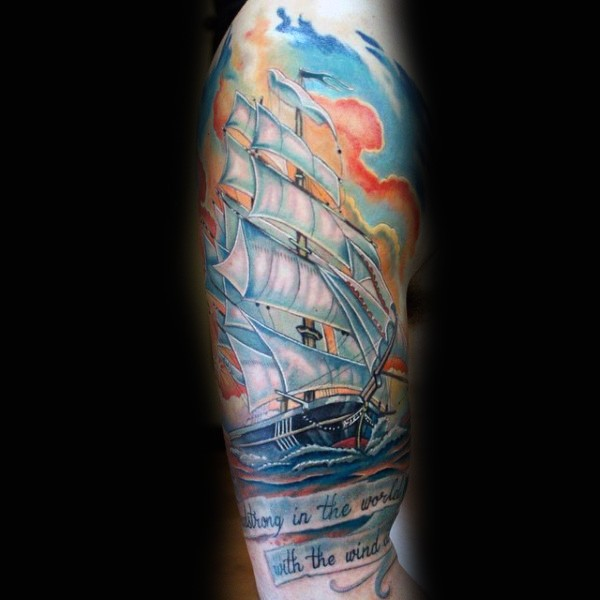 Massive multicolored old ship with lettering tattoo on sleeve