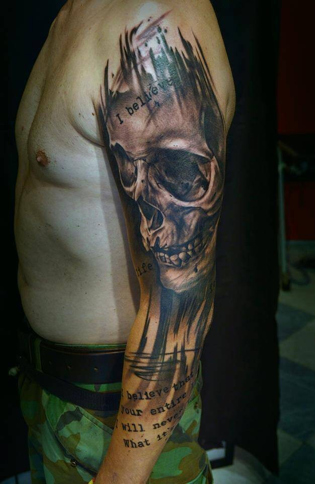 Massive multicolored sleeve tattoo of very detailed human skull and lettering