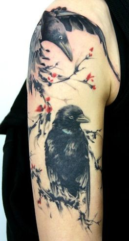 Massive natural looking colored shoulder tattoo of flying crows and tree
