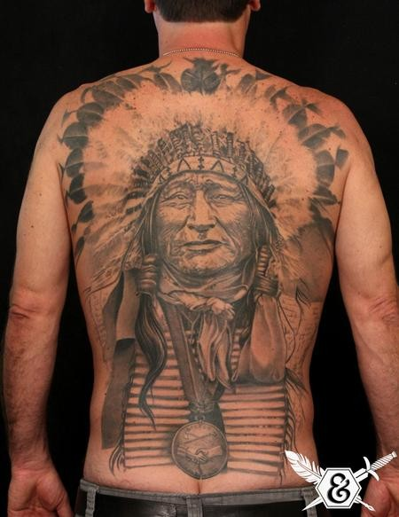 Massive real photo like black and white very detailed on whole back tattoo of old Indian chief with necklace