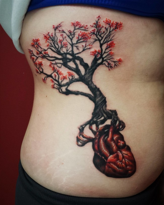 Massive tree with red blossoms with human heart instead of roots fantasy colored tattoo
